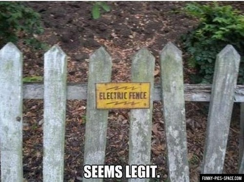 Funny Signs – 35 Pics. Electric fence sign on wood fence.