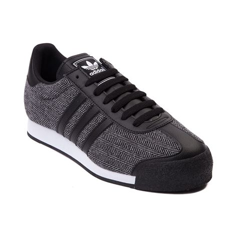 Shop for Mens adidas Samoa Textile Athletic Shoe, Black Black White, at Journeys Shoes. Textile version of the classic soccer-inspired sneaker from adidas, this Somoa Textile features a black and white herringbone patterned textile upper with black leather overlays at the toe and heel, and whats more, its available only at Journeys! Features a mesh padded collar, reinforced toe, lace closure and durable rubber outsole. Available only at Journeys!