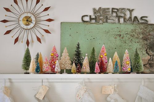 old-school mantle // Love these Christmas trees and the vintage style display.