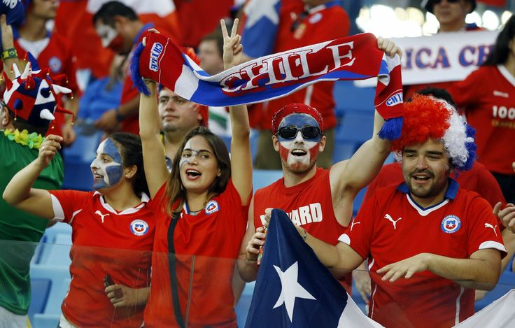 Chilean fans cheer before the start of the group B World Cup soccer match between Chile and Australia in the Arena Pantanal in Cuiaba, Brazil, Friday, June 13, 2014.