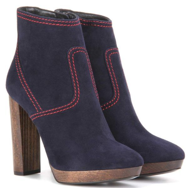 2/4/2017 - Burberry Hazelhurst 115 Suede Ankle Boots - Burberry transports the classic ankle boot to new heights, outfitting the Hazelburst 115 with dark blue suede and a high, wood-effect heel. Red stitching outlines structured panelling for cool contrast. We're pairing these with our favourite trench coat for an easy dose of London-inspired style. As seen on Meghan in February 2017 ($665   Was $950)