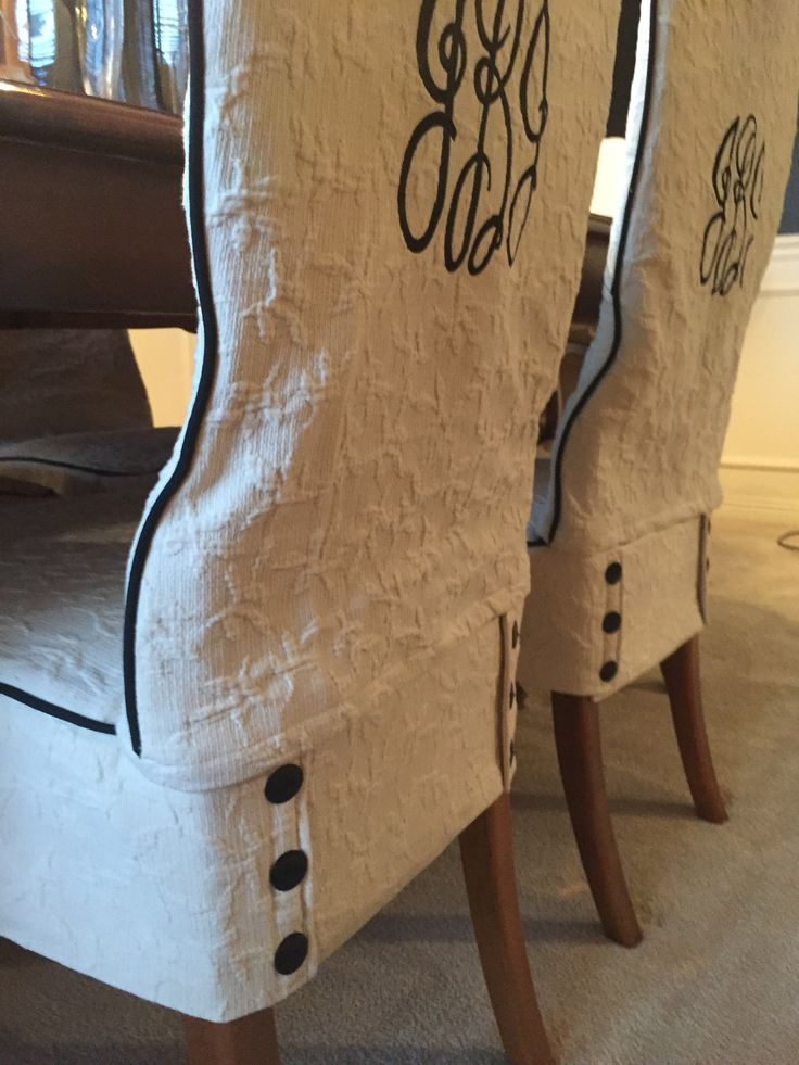Custom monogrammed dining room slipcovers constructed with