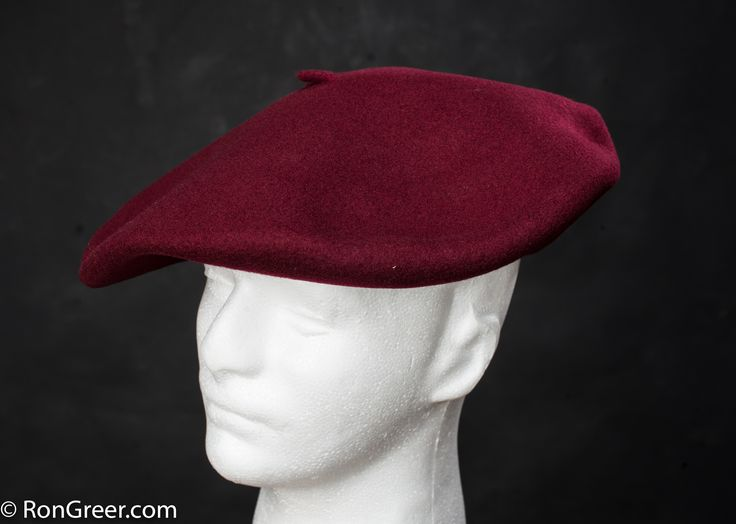12.5 inch Dark Red Basque Beret, made by Elosegui of Tolosa, Spain.  Available here; http://www.rongreer.net/basque-beret-shop/