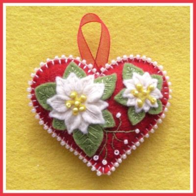 Easy Embellishment in this Free Ornament uses pre-made ribbon flowers and a needlepoint heart. Inspired by a felt ornament & from expert Janet M. Perry