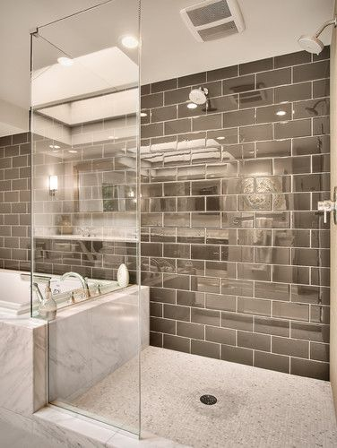 Silver subway tile and shower... Great for reflecting light in our windowless bathroom... Great marble tub deck and bathroom design.