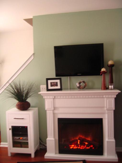 69 best hidden tv options images on pinterest hidden tv for Fireplace options