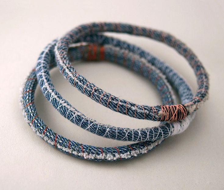 Make denim bracelets by wrapping scraps of your old jeans around slim bangles.  Source: Etsy User amberhlynn