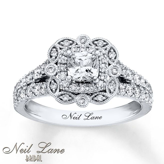 This magnificent engagement ring from Neil Lane Bridal® features breathtaking vintage-inspired details crafted of 14K white gold. A cushion-cut diamond center is complemented by round diamonds and marquise and round milgrain-decorated shapes. Round diamonds adorn the band for a total diamond weight of 1 1/8 carats. Neil Lane's signature appears inside the band. Diamond Total Carat Weight may range from 1.23 - 1.28 carats.
