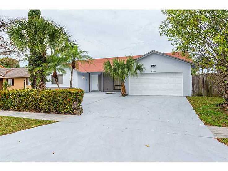 Lauderhill, FL 33319 — A one of a kind home ready for a new family to move in! the home was completely renovated with all new 20x20 tile floors throughout entire house, brand new designer kitchen with glass tile backsplash , all new appliances, new gorgeous bathrooms, with new cabinetry and granite tops, large floor plan, large master and master closet, high celing, covered  screened pool, and amaizing lake view.  interior and exterior paint was done as well. MOVE-IN READY! A MUST SEE.