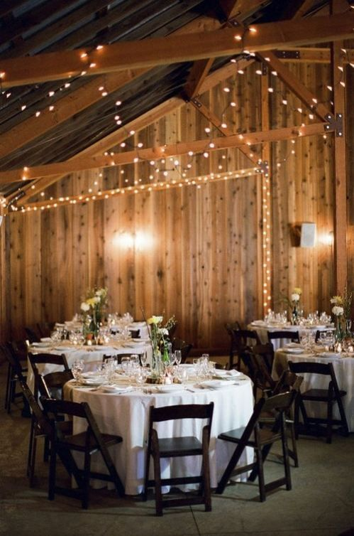 I like the idea of the string lights in the barn. Visit www.justintrails.com for more DIY wedding ideas.