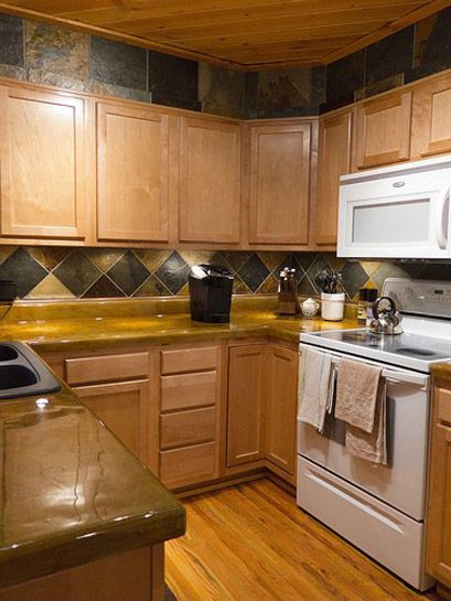 U-shaped kitchen plans are extremely versatile. In this type of plan, the counter top and kitchen appliances follow three walls (two parallel and a perpendicular wall). That's makes them potentially effective in small, medium, and large kitchens.