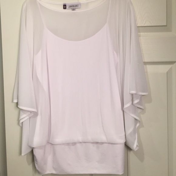 Ladies white flowing blouse size Xl Jennifer Lopez white flowing blouse size Xl worn once Jennifer Lopez Tops Blouses