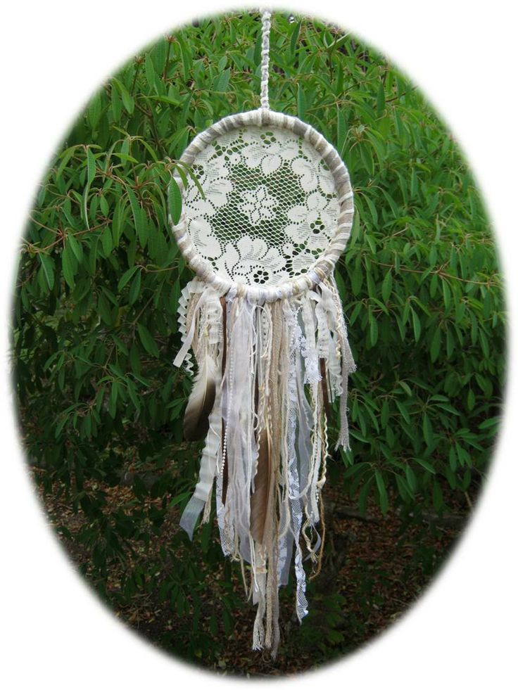 VINTAGE DREAMS Materials Used: wools, strings, beads, yarns, curtain lace, ribbons, real feathers (found&cleaned), cardboard ring. Hand Made using upcycled materials.  Measures: 22cm diameter  https://www.facebook.com/RawRoughRecycled