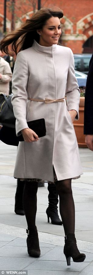 Kate was dressed in a pale grey MaxMara overcoat and dress with brown suede Aquatalia ankle boots for a visit this week to Cambridge.She lso debuted a new hairstyle, having had her long hair cut into a layrer of bangs at the cheekbone.   http://www.dailymail.co.uk/femail/article-2240119/Kate-Middleton-hair-What-Duchess-Cambridge-hiding-fringe.html#
