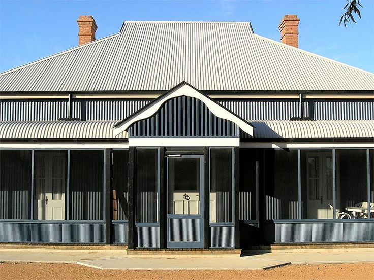Kameruka Homestead which has been restored using LYSAGHT CUSTOM ORB® in Deep Ocean® COLORBOND® steel for the cladding.
