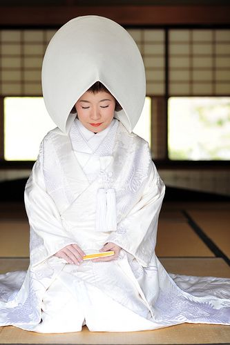 Japan....the bride wears a Shiromuku, a white wedding kimono.
