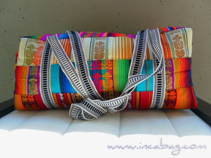 """Duffel INTI Rainbow bright- Embellished with colorful stripes with symbols representing native values. Genuine material.  Soft colorful textile   Measurements: 20"""" x 10"""" x 8"""" (inches)  http://incabag.com/products/handmade-alpaca-beach-gym-duffel-bag"""