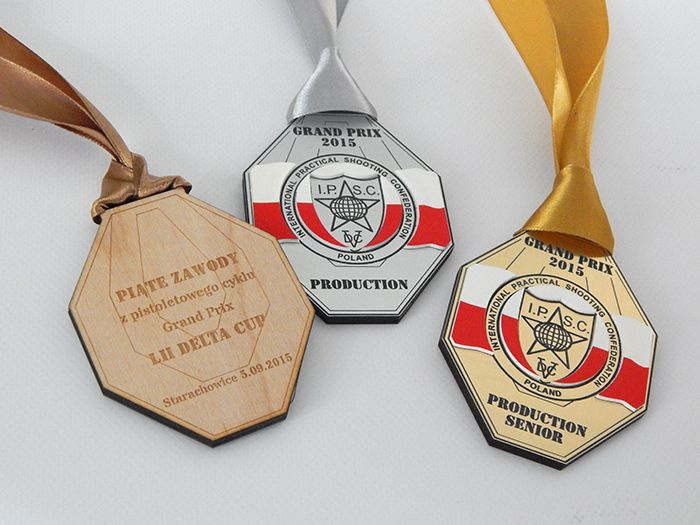 Medals for shooting competitions . Medals bilateral plywood and laminate engraving Medals bilateral Grand Prix LII Delta Cup