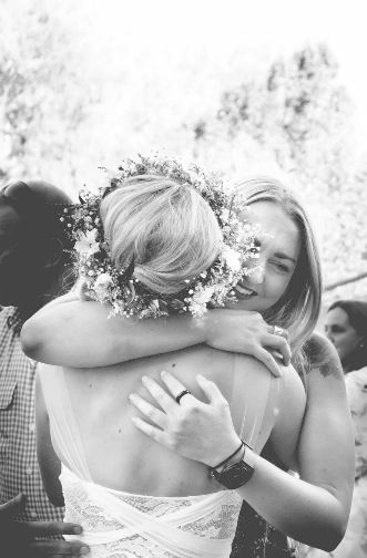 A beautiful moment captured between my sister and I at our surprise wedding