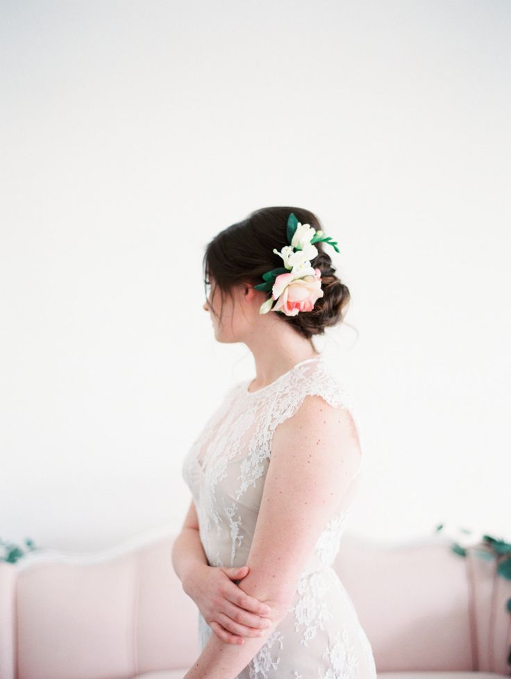 The Kaylyn Floral Comb created with ivory fressia,…