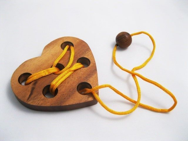 "$3.95 - HEART PUZZLE , Wooden Puzzle Game, Strategy Game, Brain Teaser, Travel size ... Remove the string from the heart (Instruction or Solution included) Dimensions: approx. 3.75"" w x 3.25 h "" x 1/2"" thick or 9.5 cm x 9 cm x 1.2 cm."