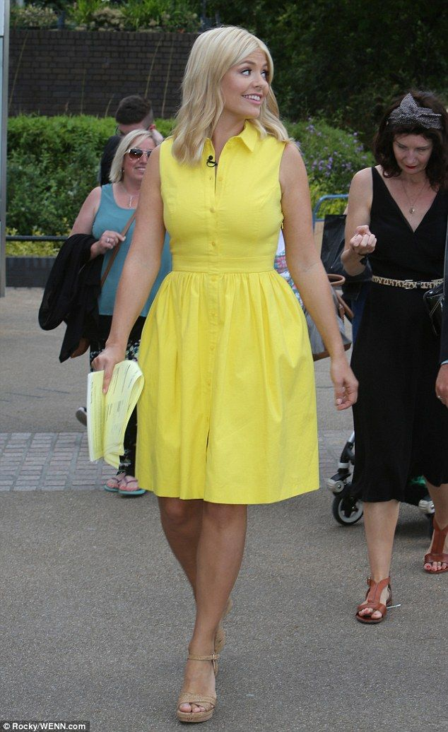 Sunny disposition: Holly Willoughby stepped out in a canary yellow gown after filming This Morning, on Monday