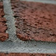 Whether you've just bought a house or want to renovate your current place, removing paint from brick surfaces is a great way to give the whole area a new look. Removing paint from brick requires patience. Brick is porous and might have absorbed the paint into deep nooks and grooves. If the bricks are outdoors, you'd be best served sandblasting off...