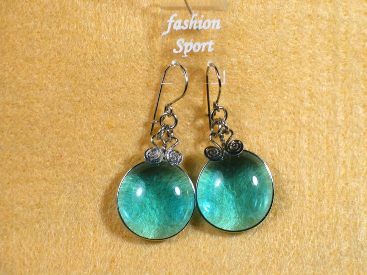Attractive Sterling Silver Handcrafted Earrings with Peruvian glass bead on Auction on EBay