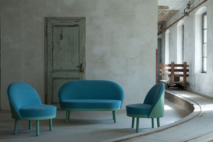 """To botton up one backrest to a bed and get a sofa, up one ottoman to get an armchair or an easychair. This is the concept of """"Paltò"""", from the italian word meaning """"Overcoat"""". just like an overcoat that protects and heats you up, these seatings are designed to envelop you in comfort for short or longer seats. The simple and rounded shapes are merging ash wood with the soft upholstery. Upholstery with non-deformable polyurethane foam covered with fabric or leather."""