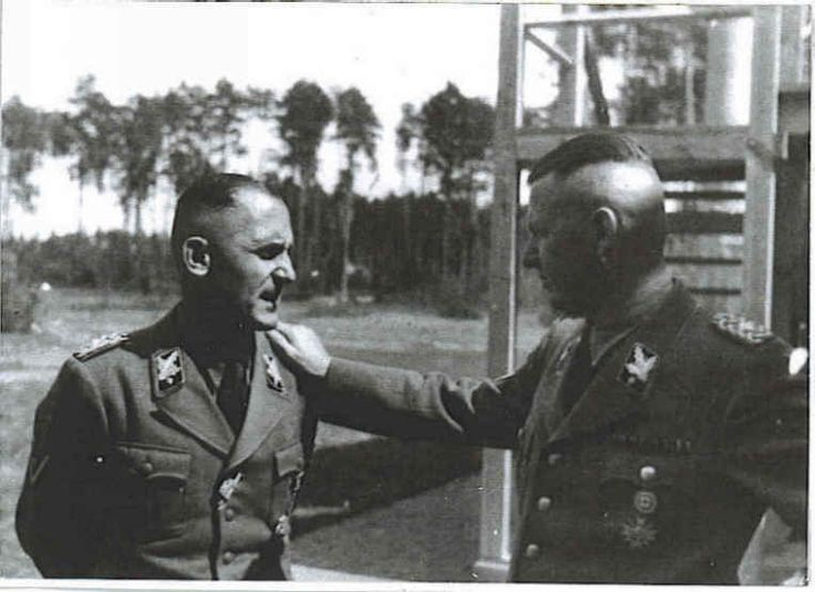 Heinrich Müller, i.e. Gestapo Müller, on the left and some other guy named Strekenbach or some other S name is on the right.