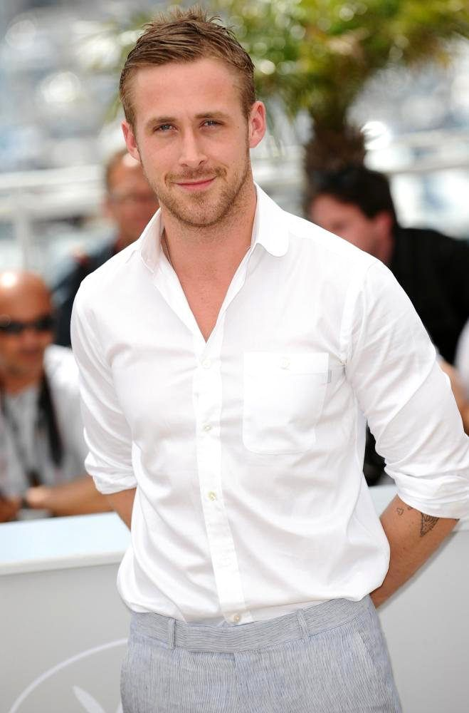 Ryan Gosling at Cannes in 2010 promoting Blue Valentine. I love this look because it's formal and appropriate for the occasion, but has his signature roughness with his rugged facial hair, undone top shirt button, and the permanent accessory of his tattoo peaking out from under his rolled up sleeves.
