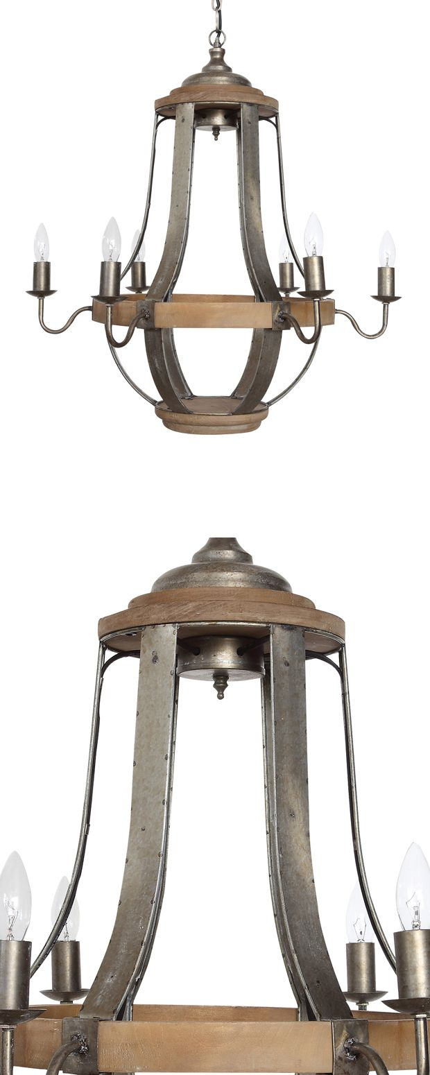You can go for a fancy motif while reclaiming the natural look of wood and metal. Picture the Danziger Lane Chandelier towering over a casual dining spot with its candelabra look. Made from rustic-look...  Find the Danziger Lane Chandelier, as seen in the A Modern Craftsman Dream Home Collection at http://dotandbo.com/collections/a-modern-craftsman-dream-home?utm_source=pinterest&utm_medium=organic&db_sku=122966