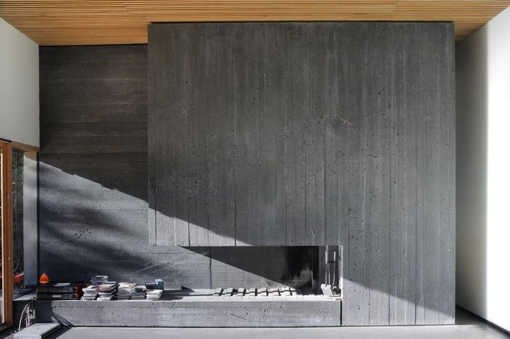 This smooth finished concrete fireplace is contemporary ands fits well within this space.
