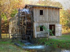 """Hardy Mill in Autumn - near Hardy, Arkansas. The Water Wheel is a reconstruction of """"Morgan's Mill,"""" which stood near here since Civil War days. A battle began here between Union and Rebel cavalries. The Rebs prevailed, chasing the Yankees all the way to where Hardy is today. Built in the 1970's, it has delighted many a traveler on U.S. Highway 62/63."""