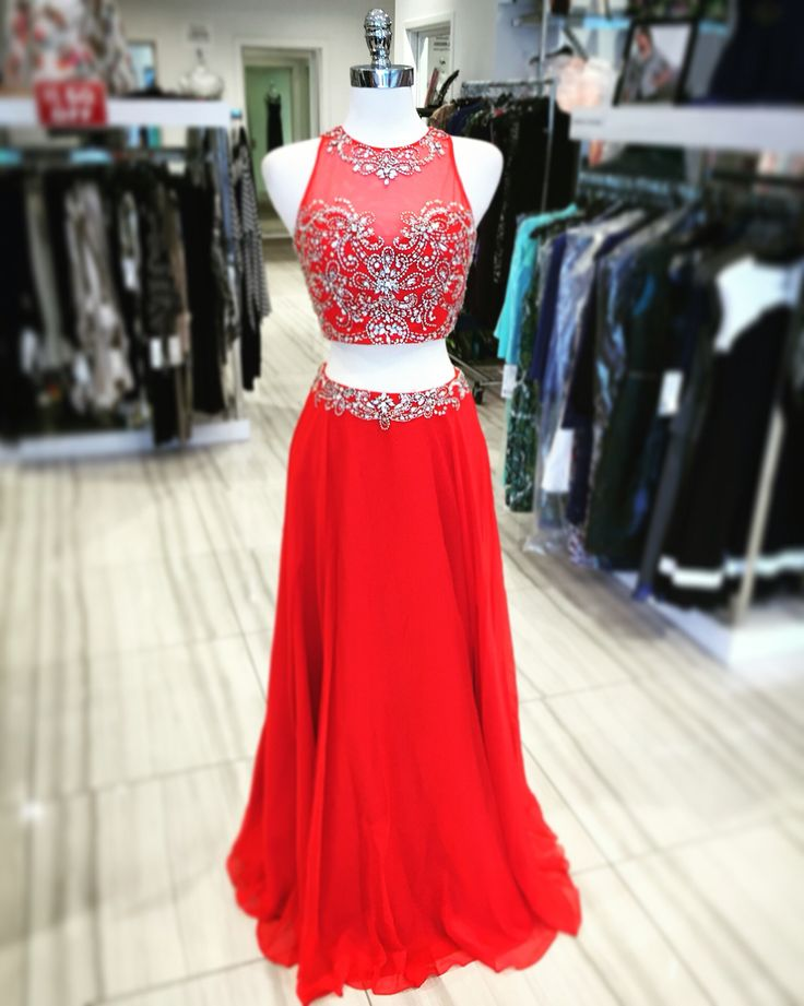 Lady in red is what you'll be in this stunning red two piece gown!