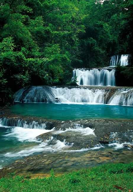 Skip the crowds at the Dunns River waterfalls. Hidden away on a cattle and horse farm, YS Falls is a spectacular series of seven tiers that plunge through a jungle canyon. For more information, see the Jamaica Destination Guide.