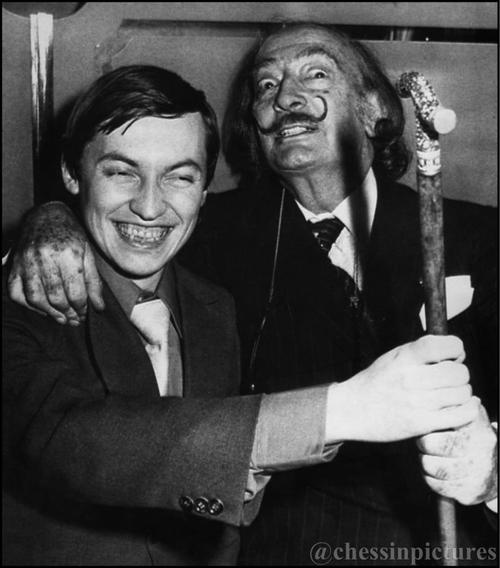 Soviet chess champion, Anatoly Karpov, is shown with artist Salvador Dali at a New York restaurant. USA, 1979.