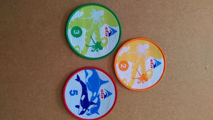 Some swimming badges, made by us