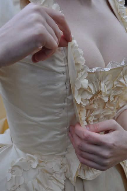 Pinned Stomacher. So apparently the stomachers were just pinned, ouch. The stomacher idea is ingenious. It allowed a fit to many shapes and weights before you have to make a whole new dress to fit.