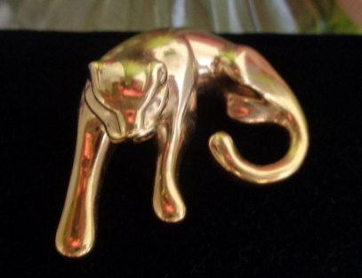 Vintage 14 kt Gold Cat Slider for a scarf or as a Pendant for a Gold Chain. The Cat Pendant is 4 grams of 14 kt Gold. Reduced to $93.00 www.CCCsVintageJewelry.com Free Shipping to the United States. Marked 14kt Gold and 4 grams.