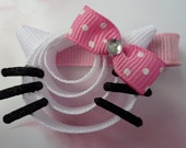 Hello Kitty Hair clip made of ribbon. $5.50. TakeABowHandcrafts.etsy.com
