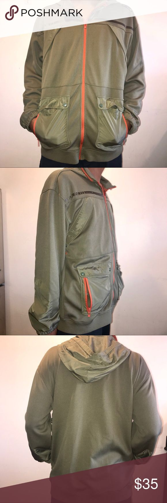 """Ecko Unlimited Army Green & Orange Zip Up Jacket Ecko Unlimited Army Green & Bright Orange Zip Up Jacket. Cotton polyester blend throughout jacket with windbreaker type material here & there on the pockets & hoodie. Slanted chest pockets, side buttoned & zippered pockets. Hood can be rolled up & zipped up in collar. Approx measurements Length 29.5"""", Width 26"""", Sleeve Length 25"""". Ecko Unlimited Jackets & Coats Lightweight & Shirt Jackets"""
