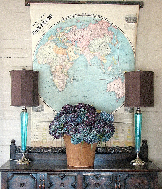 Decorating with antique pull-down maps.