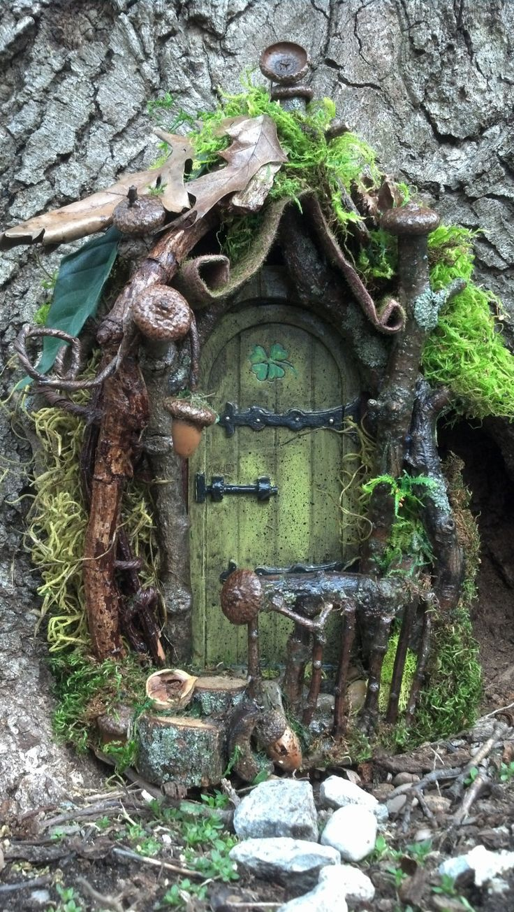 curled mossy awning fairy door and house gardens