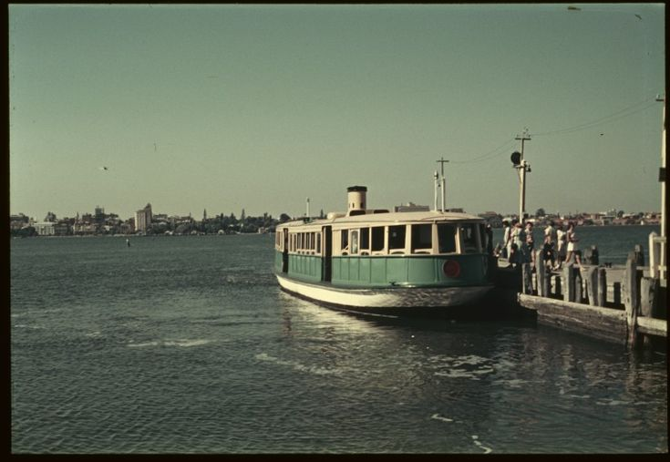 145706PD: Ferry at Mends Street Jetty, with a view across the Swan River toward Perth, Western Australia, ca. 1960. (Click to Start Zoom)
