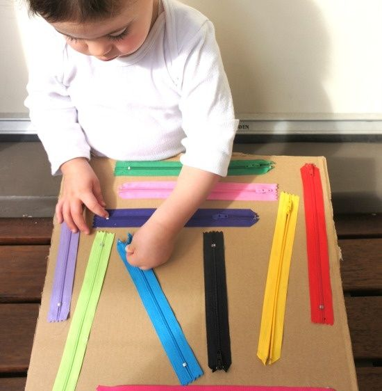 DIY Zipper Sensory Boards are easy to make & great for fine motor & sensory development. All you need are some old zips of different colours & sizes, stiff card or an old cardboard box & glue. Other Sensory Board ideas: http://www.under5s.co.nz/shop/Hot+Topics/Activities/Things+to+make/Make+your+own+sensory+board.html
