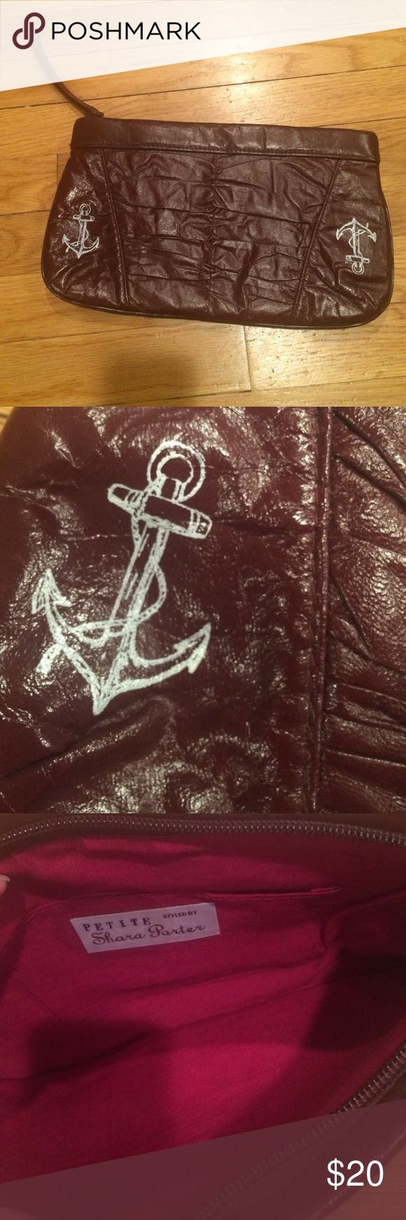 Vintage Anchor Clutch This Clutch is very unique! Love the Burgandy color and the Anchors. I used it once or twice. Inside looks new! Bags Clutches & Wristlets