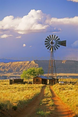 Dirt road to remote farmhouse and windmill (Utah) by Chad Ehlers
