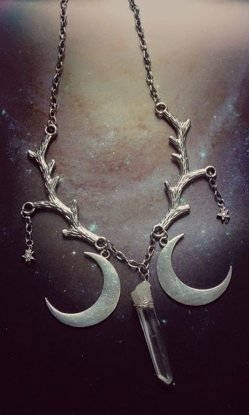 raw quartz crystal necklace with crescent moons & stars on tree branches <3