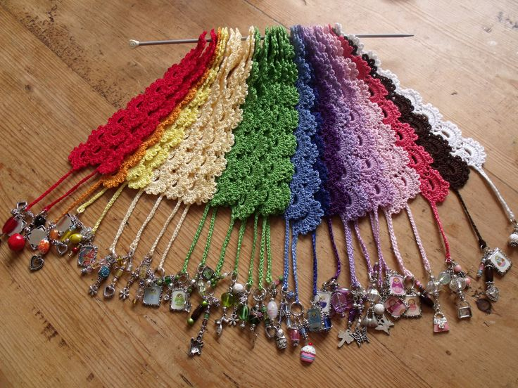 Love the little charm tassels on the ends. Looks like a shell-type stitch with picots on top, and also worked on the other side of the foundation row. --Pia (A ton of crocheted bookmarks for craft fairs, etc.)